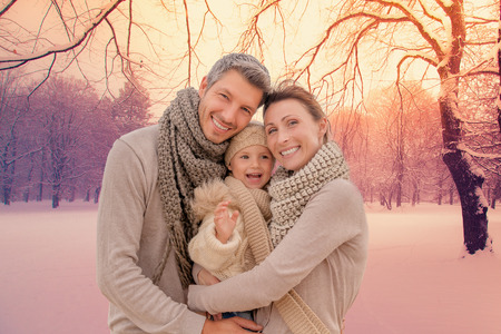 Photo pour family outdoors in winter landscape - image libre de droit