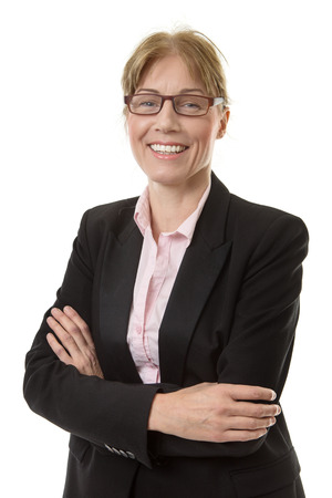 Photo for Close up shot of a smart office worker in a suit jacket, wearing glasses with her arms folded,  isolated on white. - Royalty Free Image