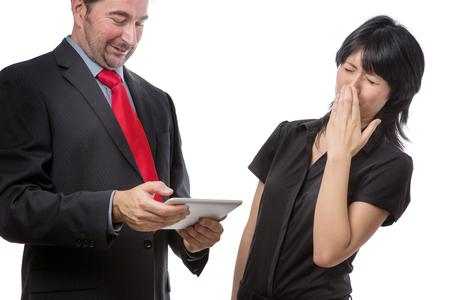 Foto de Studio shot showing co worker holding a mobile device with bad breath, isolated on white - Imagen libre de derechos