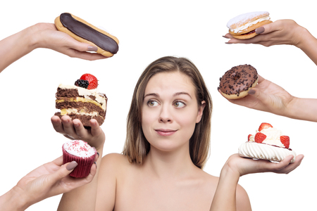 Photo for woman surrounded by many cakes - Royalty Free Image