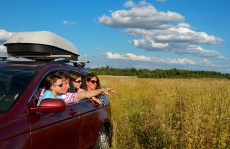 Photo pour Car trip on family vacation, happy parents and kids travel and have fun, car insurance concept - image libre de droit