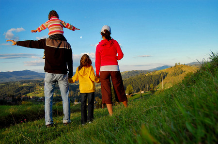 Photo pour Happy family on vacation in mountains, hiking and looking and beautiful view - image libre de droit