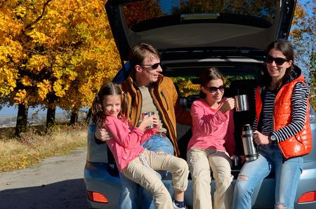 Photo pour Car trip on autumn family vacation, happy parents and kids travel and have fun, car insurance concept - image libre de droit