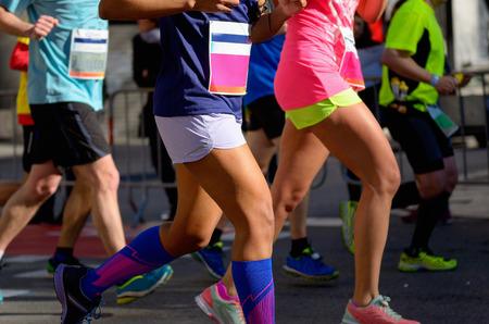 Photo pour Marathon running race, people feet on road, women run,  sport, fitness and healthy lifestyle concept - image libre de droit