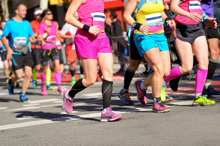 Photo pour Marathon running race, women runners feet on road, sport, fitness and healthy lifestyle concept - image libre de droit
