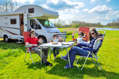 Photo pour Family vacation RV camper travel with kids happy parents with children on holiday trip in motorhome - image libre de droit