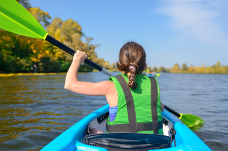 Photo for Family kayaking, child paddling in kayak on river canoe tour, kid on active summer weekend and vacation, sport and fitness concept - Royalty Free Image