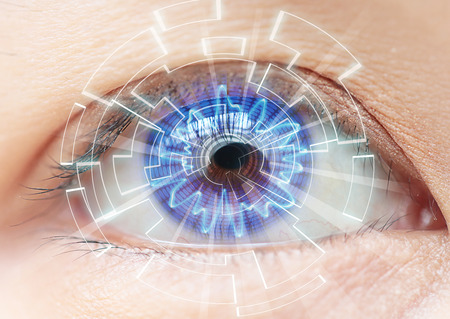 Photo for Close-up of woman's blue eye. High Technologies in the futuristic. : contact lens - Royalty Free Image
