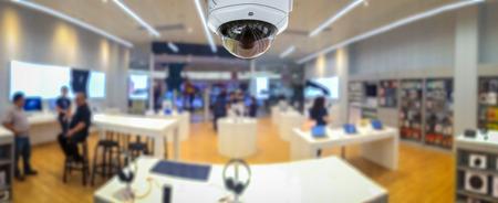 Foto de CCTV security panorama with shop store blurry background. - Imagen libre de derechos