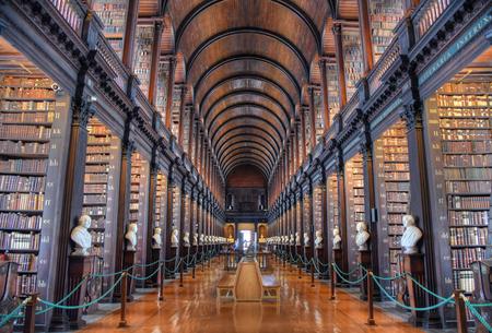 Foto de Dublin, Ireland - May 30, 2017: The Long Room in the Old Library at Trinity College Dublin. - Imagen libre de derechos