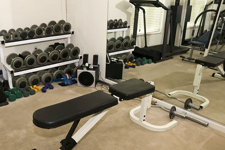 Typical Residential Weight and Exercise Room with a Mirror Wall