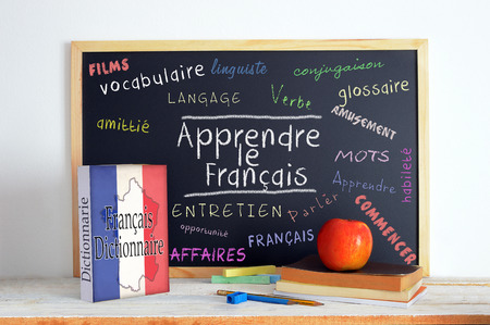 Foto de Blackboard with the message LEARN FRENCH and some text - Imagen libre de derechos