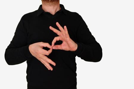 Foto de Sign language interpreter translating to meeting man to ASL, American Sign Language. Empty copy space for Editor's content. - Imagen libre de derechos