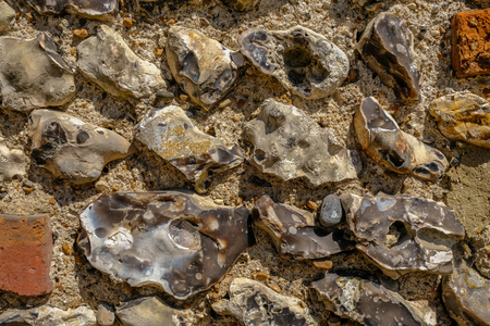 Photo for Close up background shot of an old flint wall commonly found in Sussex. - Royalty Free Image