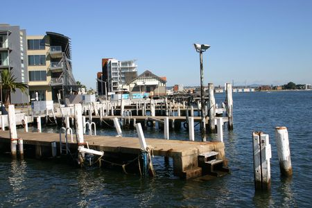 old jetty next to redeveloped harbor area - Newcastle Australia