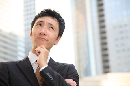 japanese businessman thinks about something