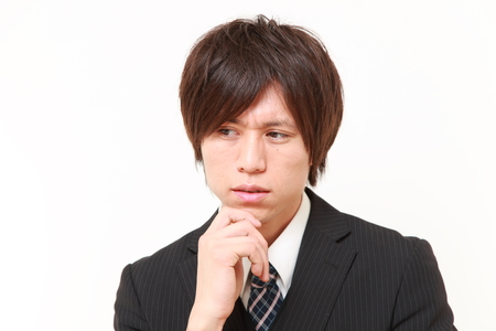 young Japanese businessman worries about something
