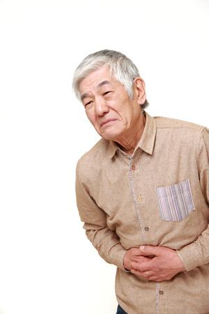 Photo pour senior Japanese man suffers from stomachache - image libre de droit