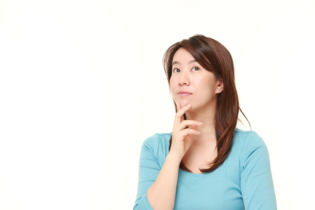 Japanese woman thinks about something