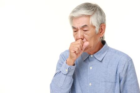 Foto de senior Japanese man coughing - Imagen libre de derechos