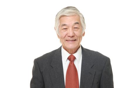 Foto de senior Japanese businessman smiles - Imagen libre de derechos