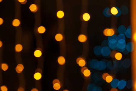 Photo for Closeup of Christmas-tree background in the living room of the house with glowing stars on the wall - Royalty Free Image