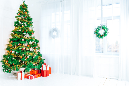 Photo for Christmas living room with a Christmas tree, gifts and a large window. Beautiful New Year decorated classic home interior - Royalty Free Image