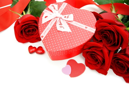 Heart shaped Valentines Day gift box with red roses over white