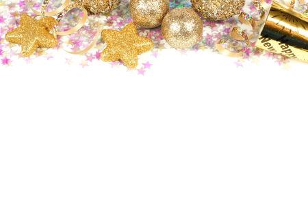 New Years Eve border of confetti and golden decorations on a white background