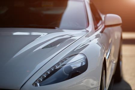 Photo pour Car detailing series : Worker waxing white car door - image libre de droit