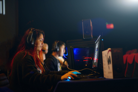 Photo pour Professional Girl Gamer Plays in MMORPG Strategy Video Game on Her Computer. - image libre de droit