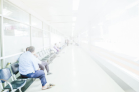 Photo pour Abstract blurred people waiting in corridor hospital interior background with defocused effect. - image libre de droit