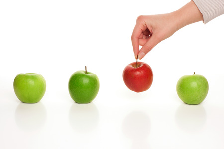 Photo for Picking different apple among similar on white - Royalty Free Image