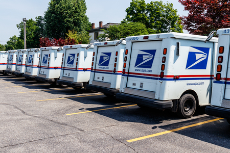 Foto de Logansport - Circa June 2018: USPS Post Office Mail Trucks. The Post Office is Responsible for Providing Mail Delivery IV - Imagen libre de derechos