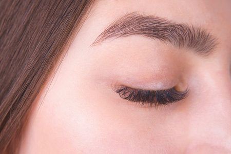 Photo pour Closed female eye with long eyelashes and beautiful eyebrow, clo - image libre de droit