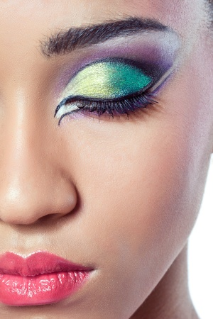Closeup shot of a beautiful young woman's face with colorful makeup