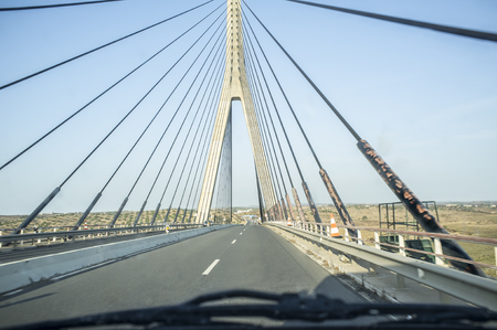 Photo pour Driving car along the Guadiana International Bridge, southernmost land crossing on the Portugal–Spain border - image libre de droit
