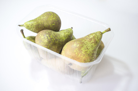 Photo pour Conference pears on their plastic package. Uncovered - image libre de droit