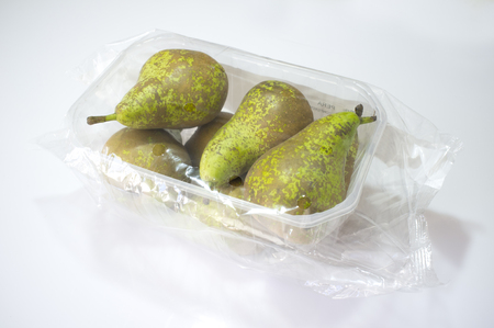 Photo pour Conference pears on their plastic package covered. Closeup - image libre de droit