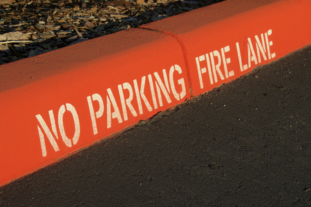 Photo for Painted red curb with no parking and fire lane - Royalty Free Image