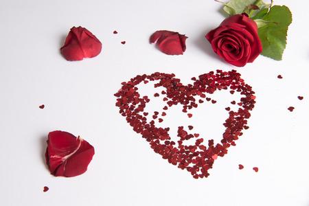 Photo pour Rose and heart of hearts as love sign - German - image libre de droit