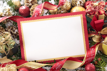 Foto de Blank Christmas card or invitation with red envelope surrounded by decorations. Space for copy. - Imagen libre de derechos
