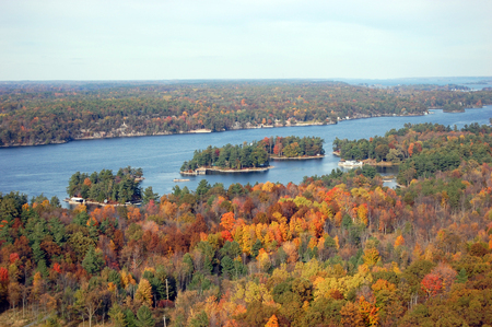 Photo for Aerian view of Thousand Islands in fall, from Sky deck on Hill Island, on the border of Ontario in Canada and New York State in USA. - Royalty Free Image