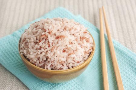 Foto de Rice berry, Brown rice and chopsticks in bowl - Imagen libre de derechos
