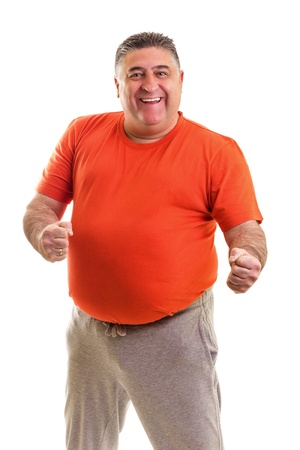 Portrait of a happy fat man posing in studio against white background