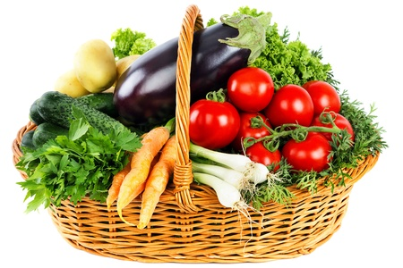 Photo pour Fresh vegetables in basket isolated on white - image libre de droit
