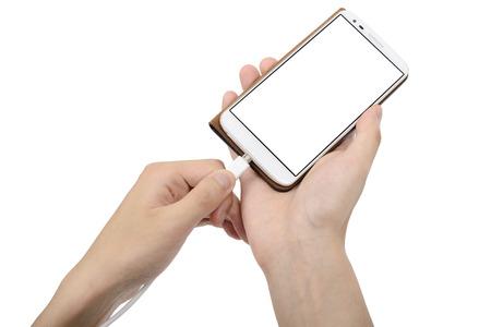 Foto de smart phone in case and charging cable on a hand - Imagen libre de derechos