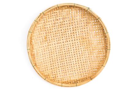 Foto de Wooden threshing basket (bamboo) isolated on white background - Imagen libre de derechos