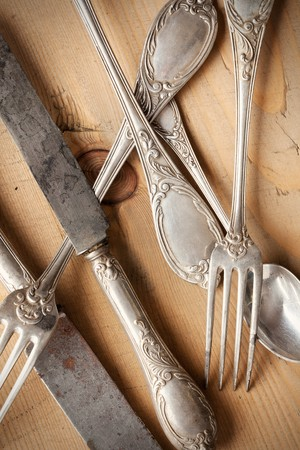 the old cutlery on wooden table