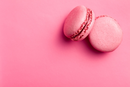 Photo for top view of tasty pink macaroons  - Royalty Free Image